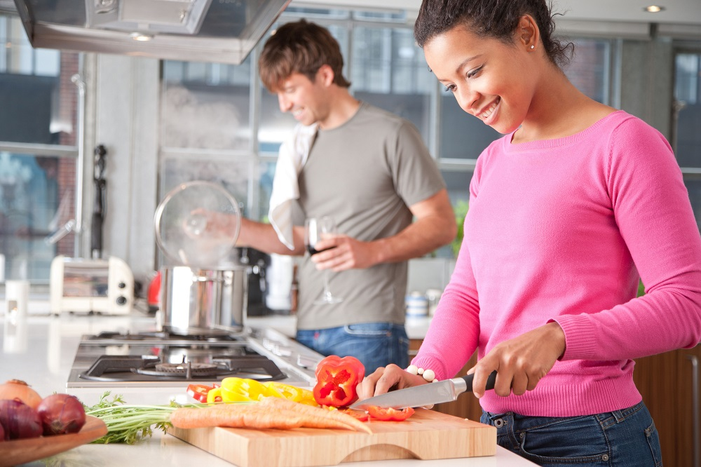 Couple cooking in home kitchen