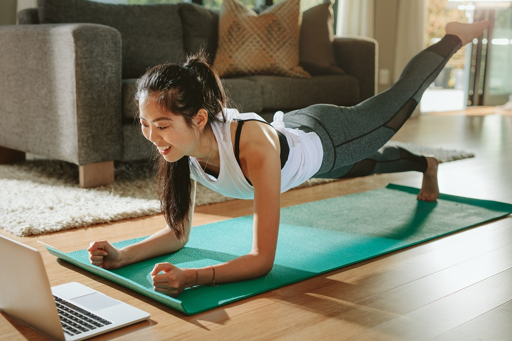 Female doing exercises at home