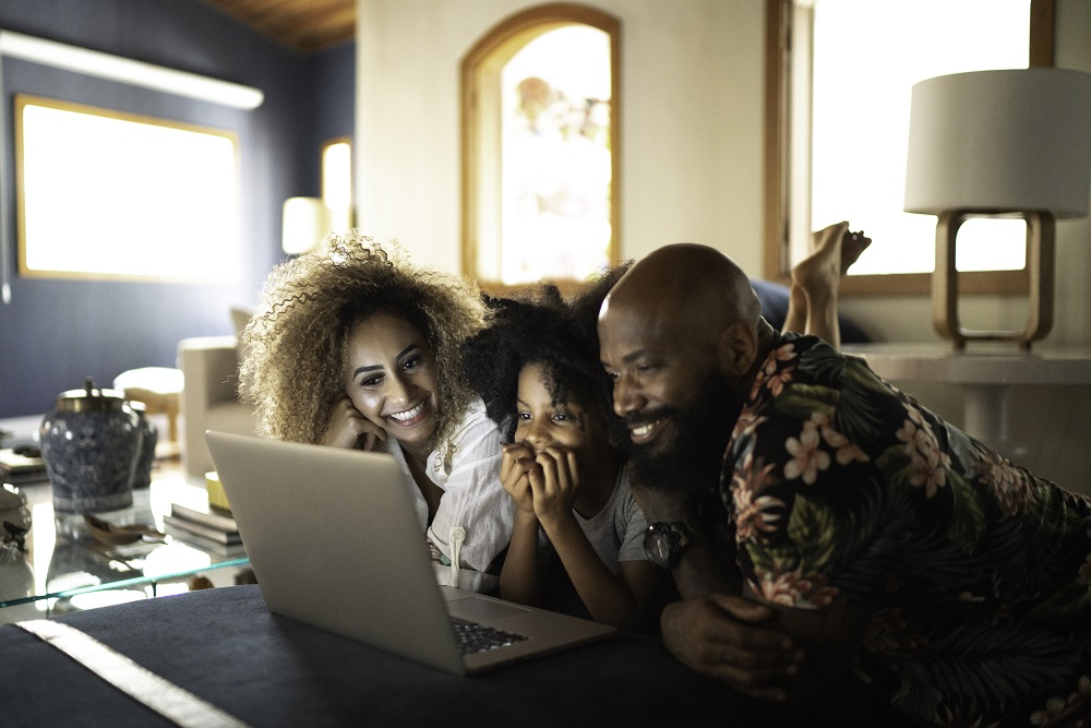 Family watching videos on laptop