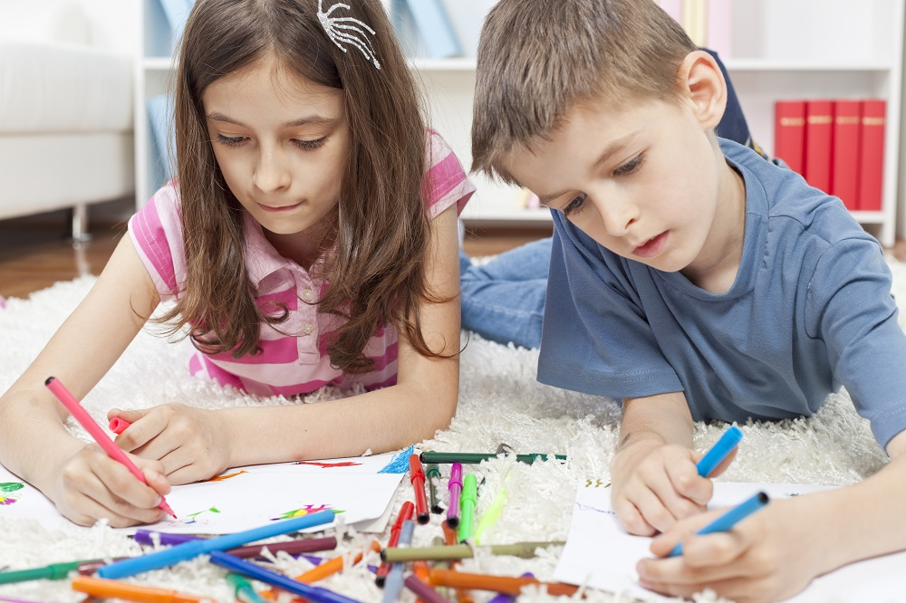 Siblings doing art at home