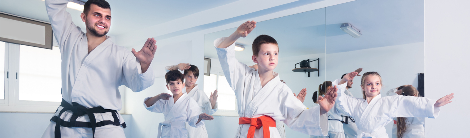 Karate classroom with teacher and students