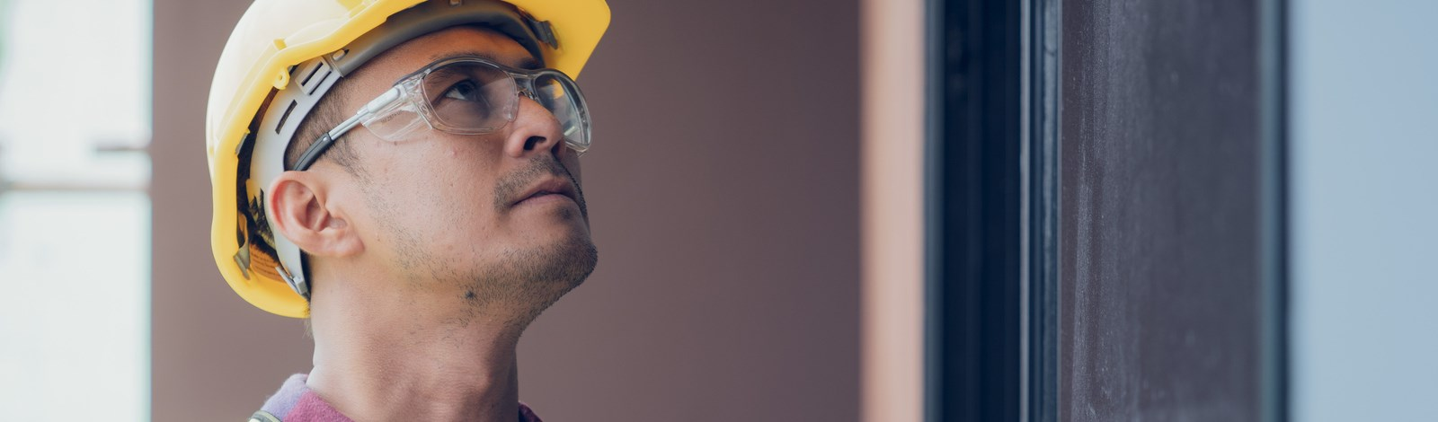 Construction Inspector with safety glasses and yellow hard hat
